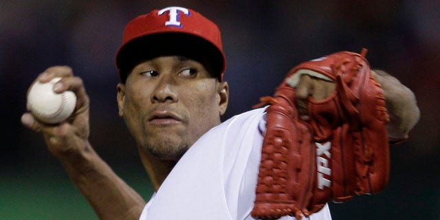 Texas Rangers relief pitcher Alexi Ogando throws during the seventh inning of Game 5 of baseball's World Series against the St. Louis Cardinals Monday, Oct. 24, 2011, in Arlington, Texas. (AP Photo/Matt Slocum)
