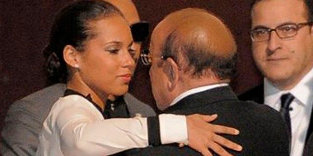 Feb. 12, 2012: Alicia Keys, left, hugs Clive Davis at the loading dock outside the Beverly Hilton Hotel.