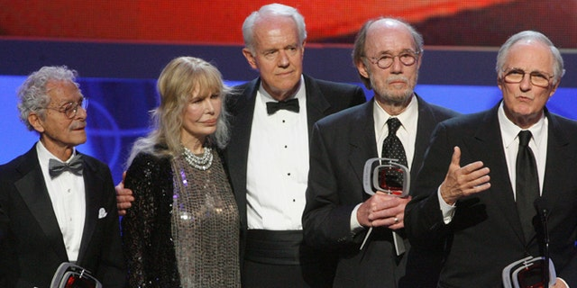 """Cast members of """"M*A*S*H*"""" (L-R) Allan Arbus, Loretta Swit, Mike Farrell, Burt Metcalfe and Alan Alda accept the Impact award at the taping of the seventh annual TV Land Awards in Los Angeles, California April 19, 2009."""
