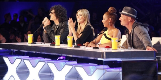 """America's Got Talent"" judges (left to right) Howard Stern, Heidi Klum, Mel B and Howie Mandel are shown."