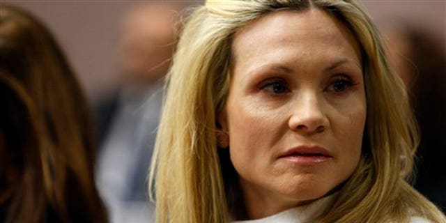 """This Nov. 27, 2012 file photo shows former """"Melrose Place"""" actress Amy Locane-Bovenizer in court as the jury in her trial returns a verdict in Somerville, N.J."""