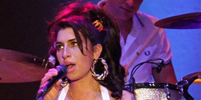 Jan. 8, 2011: In this file photo, British artist Amy Winehouse performs during her show in Florianopolis, Brazil.