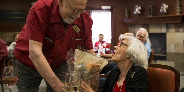 Andy Carver continued his tradition of handing out a bouquet of flowers several months after he moved into the Lakeline Oaks Retirement Resort in Cedar Park, Texas. He does it to honor his wife's memory.