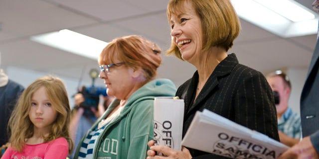 Nevada Republican Senate candidate Sharron Angle gets in line to cast her vote in Reno, Nev.
