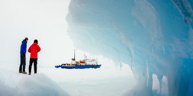Passengers from the trapped Russian ship MV Akademik Shokalskiy walk around the ice, Dec. 31, 2013.
