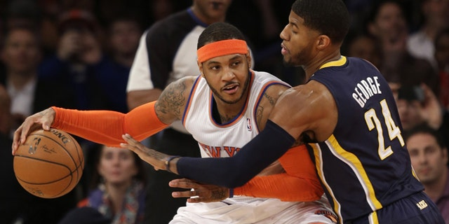 Anthony tries to move around Indiana Pacers' Paul George in this March 19, 2014, file photo.