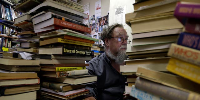 Geoff Klass works on a computer in his bookstore containing some 2 million books and prints in Johannesburg.