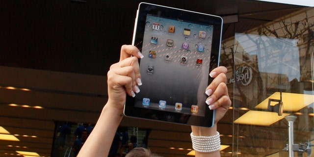 Apple employees cheer as the iPad 2 goes on sale at The Grove Apple store in Los Angeles Friday, March 11, 2011.