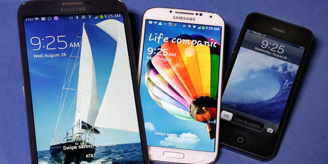 Aug. 28, 2013: The 6.3-inch Samsung Galaxy Mega, left, the 5.0-inch Samsung Galaxy S4, center, and 4.0-inch Apple iPhone 5. Reports suggest Apple is investigating larger screen sizes for its flagship phone, up to 6 inches.