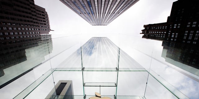 The Apple logo hangs in a glass enclosure above the 5th Ave Apple Store in New York, Sept. 20, 2012.