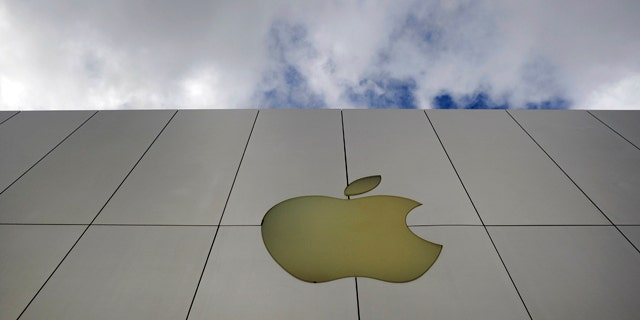 The Apple logo is displayed outside one of the company's stores.