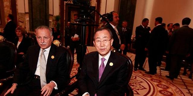 March 29, 2012: United Nations Secretary-General Ban Ki-moon, center, attends the Arab League summit in Baghdad, Iraq.