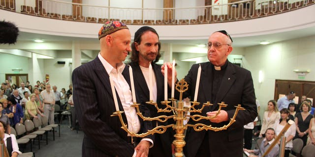 Dec. 12, 2012: Picture provided by the NCI-Emanue El; Archbishop of Buenos Aires, Cardinal Jorge Mario Bergoglio, right, lights the Janukia during Hanukkah celebrations in Buenos Aires, Argentina, At left is Rabbi Sergio Bergman, and at right is Rabbi Alejandro Avruj, of the NCI-Emanu El congregation.