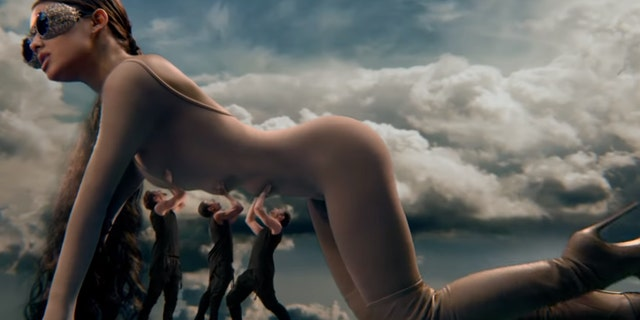 """Singer Ariana Grande has been accused of ripping off an old Jean Paul Gaultier ad in her new music video, """"God Is a Woman"""""""