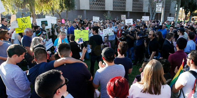 Nearly 250 gay rights supporters protest SB1062 at the Arizona Capitol, Friday, Feb. 21, 2014, in Phoenix.