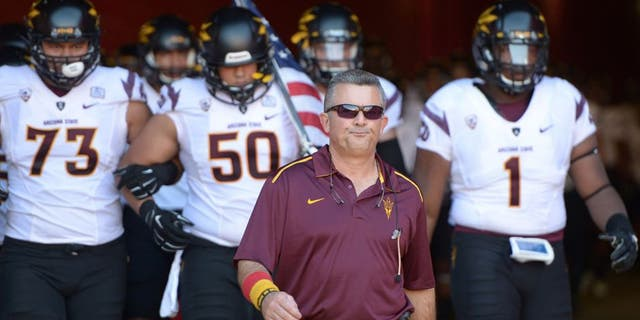 Oct 4, 2014; Los Angeles, CA, USA: Arizona State Sun Devils coach Todd Graham leads players onto the field before the game against the Southern California Trojans at Los Angeles Memorial Coliseum. Mandatory Credit: Kirby Lee-USA TODAY Sports