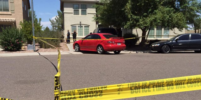 Aug. 30, 2015: Police stand outside a house where twin 2-year-old boys drowned in Avondale, Ariz. (KSAZ)