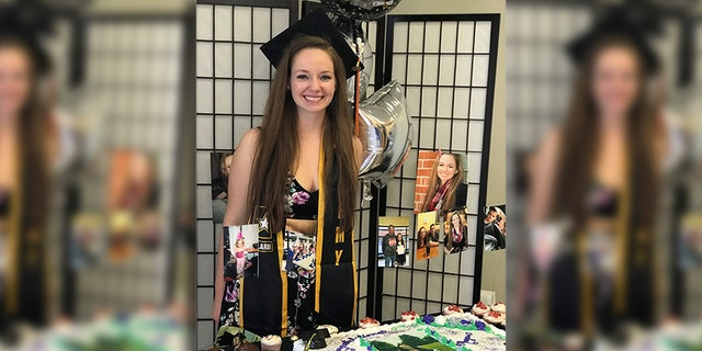 Despite being told no, Pohlmeier decided to wear her sash tucked under her graduation gown so she could take pictures with it after the ceremony.