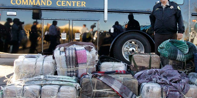 Jan. 27: Maricopa County Sheriff Joe Arpaio stands in front of bales of marijuana seized by his deputies, after speaking at a news conference. There he announced his latest crime suppression illegal immigration operation sweep at the Maricopa County Sheriff's Training Academy in Phoenix.
