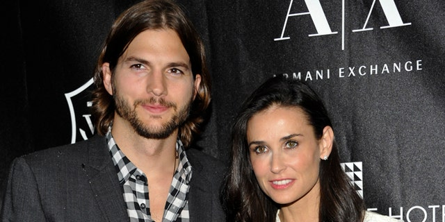 """An industry source told People Demi Moore, right,""""was confused about her life and what direction her career would take as she got older"""" after split from Ashton Kutcher, left."""