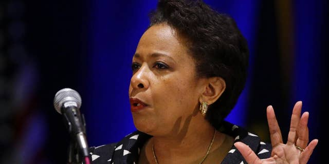 FILE - In this Monday, July 13, 2015, file photo, U.S. Attorney General Loretta E. Lynch delivers the keynote address at the National Organization of Black Law Enforcement Executives training conference in Indianapolis.  Lynch is bringing her national community policing tour to Connecticut, where she will highlight changes East Haven police have made over the last several years to strengthen ties with local residents. (AP Photo/Michael Conroy, File)