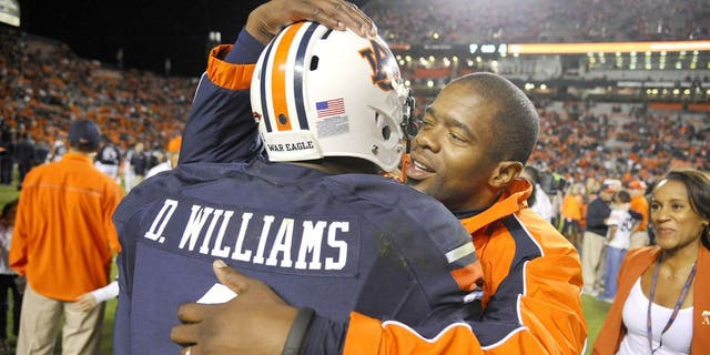 Oct 4, 2014; Auburn, AL, USA; Auburn Tigers wide receiver D'haquille Williams (1) hugs co-offensive coordinator Dameyune Craig after the game against the LSU Tigers at Jordan Hare Stadium. Auburn won 41-7. Mandatory Credit: Shanna Lockwood-USA TODAY Sports