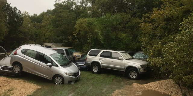 The fast-moving floodwaters were so strong, vehicles were swept away and ended up piled up.