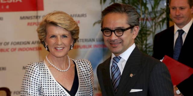 """FILE - In this Dec. 5, 2013 file photo, Australian Foreign Minister Julie Bishop, left, is greeted by his Indonesian counterpart Marty Natalegawa prior to their meeting in Jakarta, Indonesia. Australia and Indonesia have reached a new agreement on how they'll use their intelligence operations in the future, even settling their disagreement on its name. The agreement Bishop and Natalegawa are scheduled to sign Thursday, Aug. 28, 2014 on the Indonesian resort island of Bali is designed to mend a rift sparked last November by accusations that Australians tapped the cellphones of the Indonesian president, his wife and eight ministers and officials in 2009. The document with the ungainly title of """"Australia-Indonesia Joint Understanding on a Code of Conduct"""" was insisted upon by the Indonesians before diplomatic relations are normalized. (AP Photo/Tatan Syuflana, File)"""