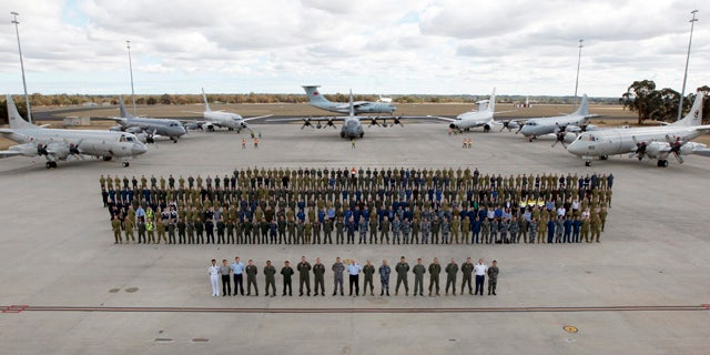 April 29, 2014: In this photo provided by the Australia Defence Force, multinational air-crew and aircraft involved in operation 'Southern Indian Ocean' are assembled for a photo at RAAF Base Pearce, in Perth, Western Australia. Seven nations, including Australia, New Zealand, the U.S., South Korea, Malaysia, China and Japan, have flew daily search mission out to the southern Indian Ocean in the massive multinational hunt for the missing Malaysia Airlines Flight 370. (AP Photo/Australian Defence Force, Cpl. Nicci Freeman)