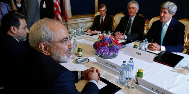 July 13, 2014: Iran's Foreign Minister Mohammad Javad Zarif, left, meets with U.S. Secretary of State John Kerry, right, at talks between the foreign ministers of the six powers negotiating with Tehran on its nuclear program in Vienna. (AP Photo/Jim Bourg, Pool)