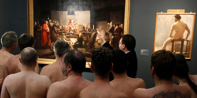 """Feb. 18, 2013: Naked Museum visitors look at pictures of the show """"Nude Men from 1800 to Today"""" during a special opening to friends of nudism at the Leopold Museum, Vienna, Austria."""