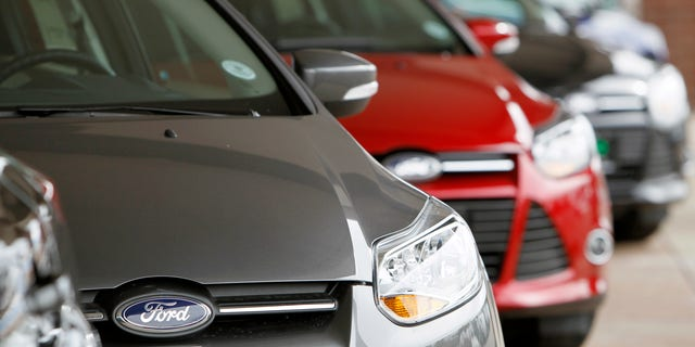 This Feb. 19, 2012 photo,  shows a line of 2012 Focus sedans at a Ford dealership in the south Denver suburb of Littleton, Colo. Ford Motor Co. said Thursday, March 1, 2012, its U.S. sales rose 14 percent in February thanks to big demand for its Focus compact car. (AP Photo/David Zalubowski)