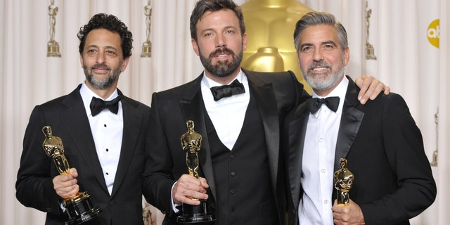 "Grant Heslov, from left, Ben Affleck, and George Clooney pose with their award for best picture for ""Argo"" during the Oscars at the Dolby Theatre on Sunday Feb. 24, 2013, in Los Angeles."