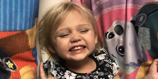 The 2-year-old undergoes physical therapy two times per day and is working to regain full use of her left hand.