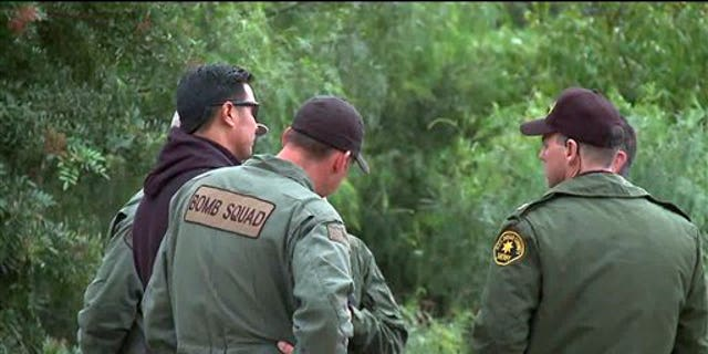 Nov. 24, 2010: Image provided by KSWB-TV shows San Diego County Sheriff Bomb Squad officers at the site of a discovery of explosive material inside a home in Escondido, Calif. The officers also seized evidence that suggested use for armed robberies.