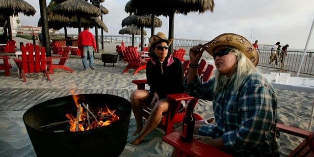 ROSARITO, MEXICO - APRIL 1: Carol Arthur (R) and Tammy Delu, from Seattle, sit at a bar along the beach April 1, 2009 in Rosarito, Mexico. (Photo by Sandy Huffaker/Getty Images)