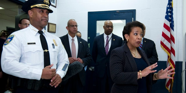 May 5, 2015: Attorney General Loretta Lynch, right, accompanied by Baltimore police Commissioner Anthony Batts, speaks to Baltimore police officers during a visit to the Central District of Baltimore Police Department. (AP Photo/Jose Luis Magana,  Pool)