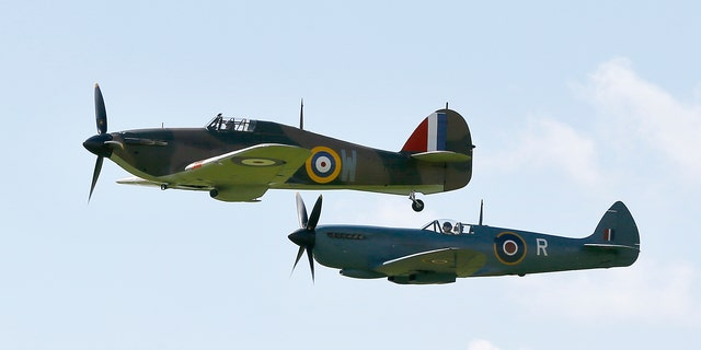 Battle of Britain aircraft fly during a display at Goodwood Aerodrome in West Sussex, England, Tuesday, Sept. 15, 2015.