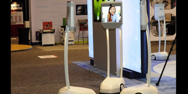 Telepresence robots -- essentially Skype machines that you can wheel around -- attend a conference on robobusiness in California.