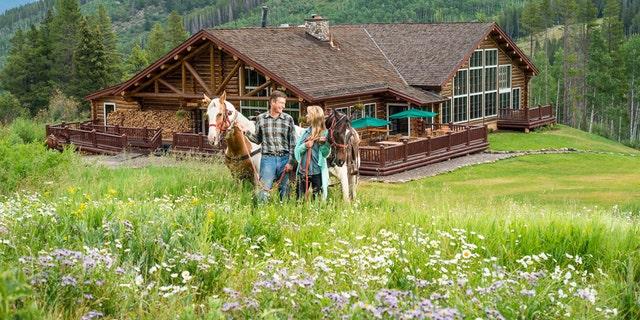 Arriving at Beano's Cabin on Beaver Creek, Colorado by horseback.