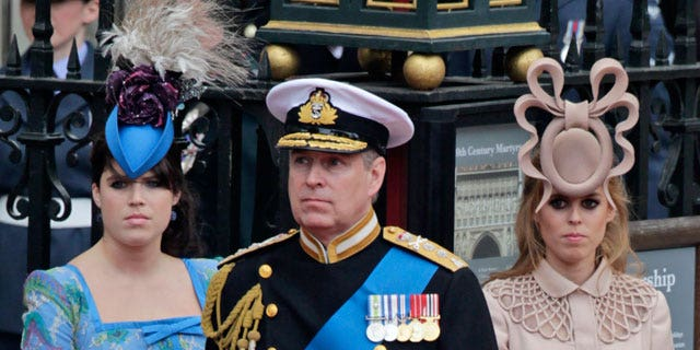 In this Friday, April 29, 2011 file picture Britain's Prince Andrew, center, and his daughters Britain's Princess Eugenie, left, and Britain's Princess Beatrice leave Westminster Abbey at the Royal Wedding in London.