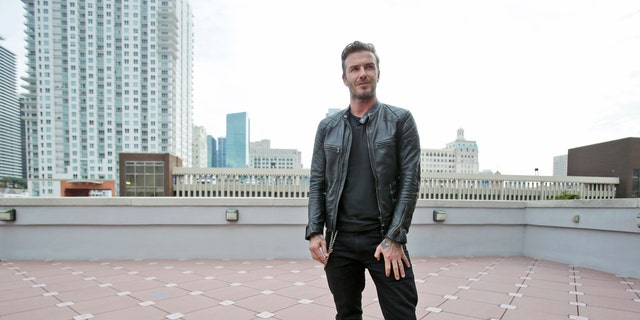 March 24, 2014: In this file photo, former England soccer star David Beckham speaks during a news conference in Miami.