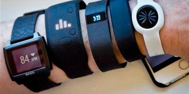 Fitness trackers are displayed in New York.