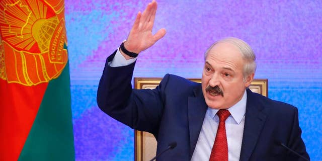 FILE - In this Thursday, Jan. 29, 2015 file photo, Belarusian President Alexander Lukashenko speaks during a news conference in Minsk, Belarus. The parliament of Belarus decided Tuesday, June 30, 2015, to set the next presidential election for Oct. 11, about a month earlier than originally planned. The decision intensified a debate among opposition parties on whether to put forward candidates for an election all but certain to be won by Alexander Lukashenko, who has ruled the former Soviet republic with an iron grip since 1994. (AP Photo/Sergei Grits, file)
