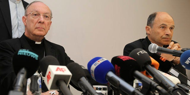 In this April 23, 2010 file photo, Belgium's Archbishop Andre-Joseph Leonard, and commission chairman Peter Adriaenssens address the media in Brussels about the sexually abuse of a Bishop. A Belgian  commission looking into sexual abuse by Catholic clergy says it has received testimony from hundreds of victims and that witnesses say widespread abuse over decades led to at least 13 suicides. (AP)