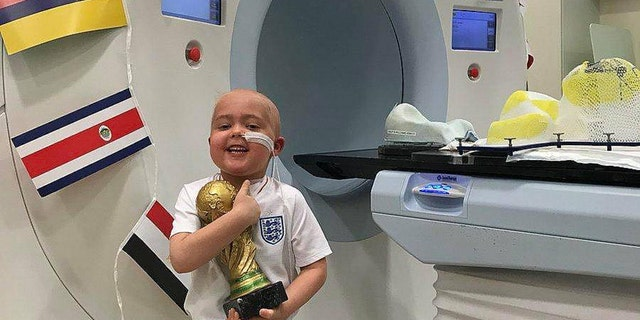 """After surviving six weeks of radiotherapy treatment, five-year-old Ben Williams received his very own """"World Cup"""" trophy."""