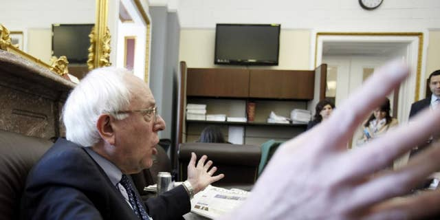 Sen. Bernard Sanders, I-Vt., speaks to reporters about his position on the tax compromise, Tuesday, Dec. 7, 2010, on Capitol Hill in Washington. (AP Photo/Harry Hamburg)