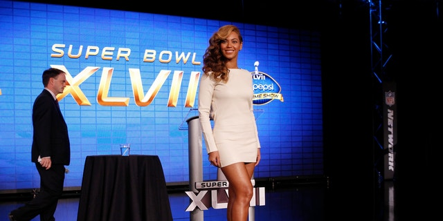 Recording artist Beyonce poses after the halftime show press conference ahead of the NFL's Super Bowl XLVII in New Orleans, Louisiana, January 31, 2013.