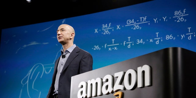 File photo - Amazon CEO Jeff Bezos discusses his company's new Fire smartphone at a news conference in Seattle, Washington June 18, 2014.