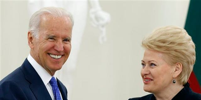 Vice President Joe Biden, left, and  Lithuania's President Dalia Grybauskaite speak prior to their meeting at the Presidential Palace in Vilnius, Lithuania, Wednesday, March 19, 2014. Biden arrived in Vilnius for consultations with Grybauskaite and Latvia's President Andris Berzins, a few hours after Russian President Vladimir Putin approved a draft bill for the annexation of Crimea, one of a flurry of steps to formally take over the Black Sea peninsula. (AP Photo/Mindaugas Kulbis)